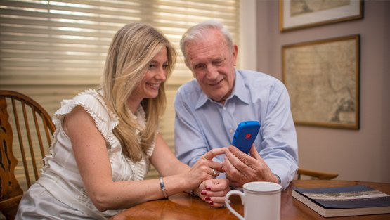 Senior couple holding mobile phone